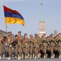 Armenian military personnel march along Red Square during a military parade in Moscow